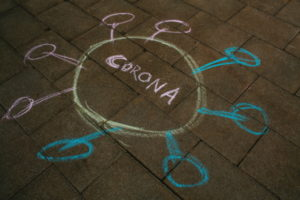 corona virus drawn in chalk